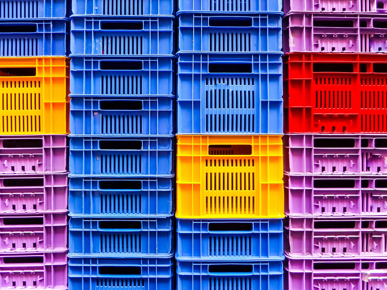 Empty plastic crates stacked up on each other