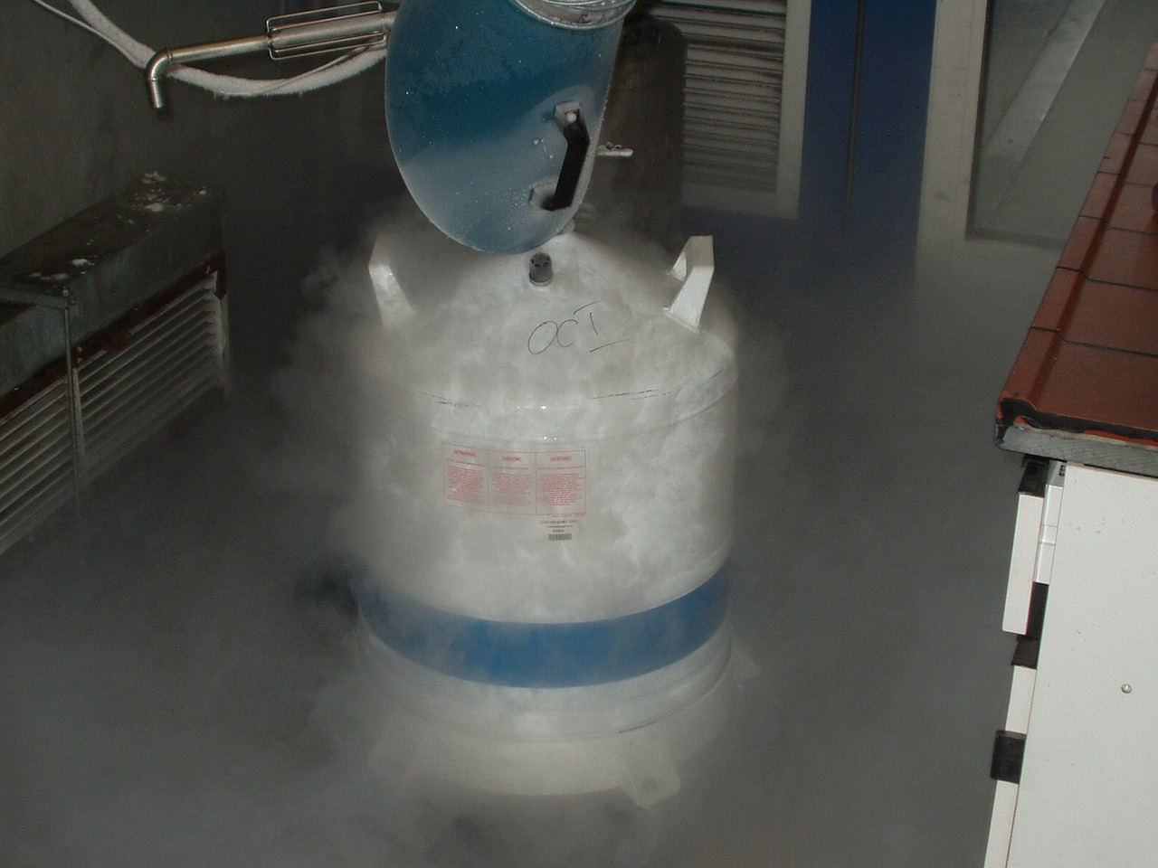 nitrogen being poured into a container causing white smoke to fall out