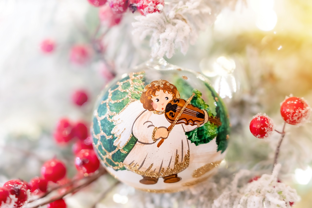 Close up of an angel painted on a Christmas ornament ball