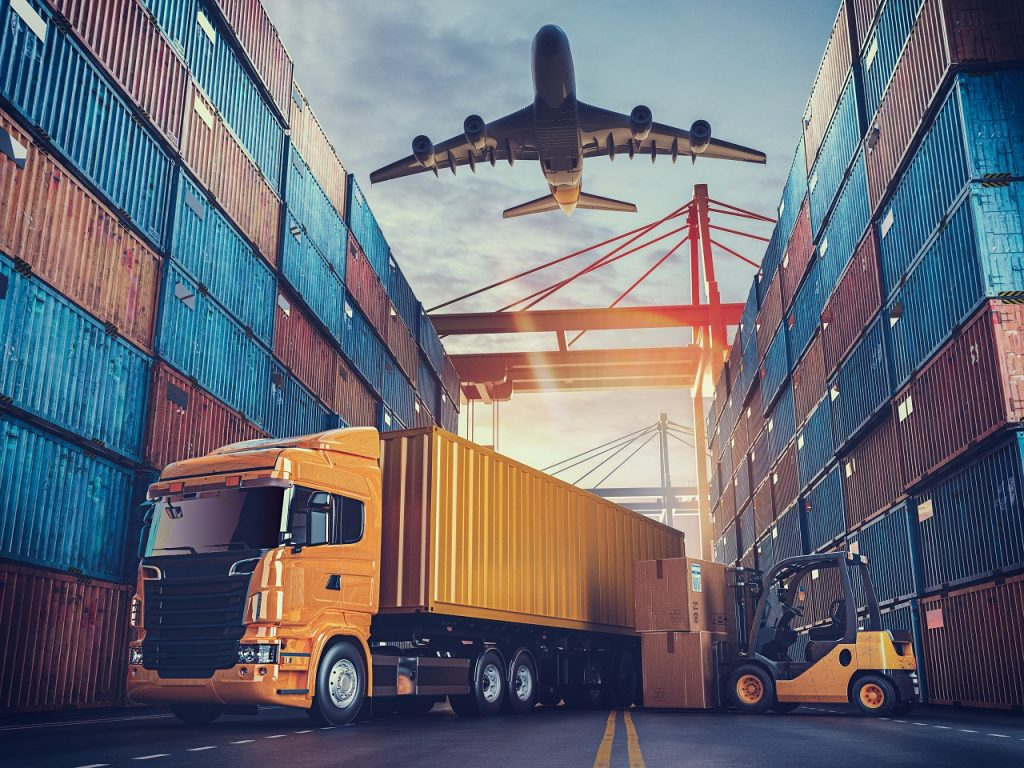 A truck, plane, and logistic containers