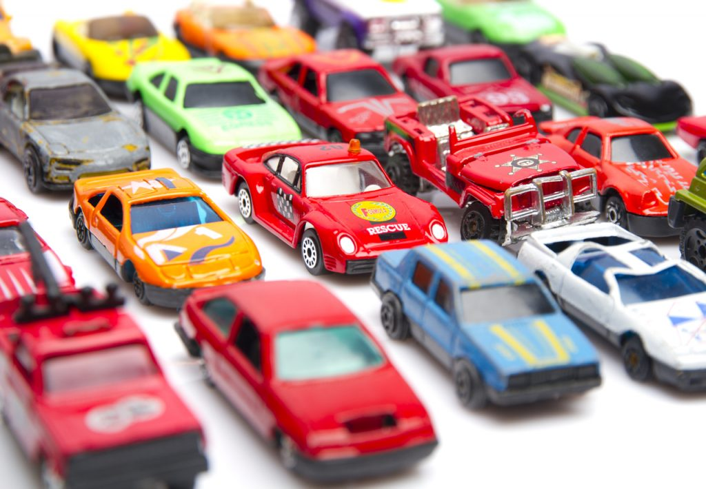 Little toy cars of different colors and designs