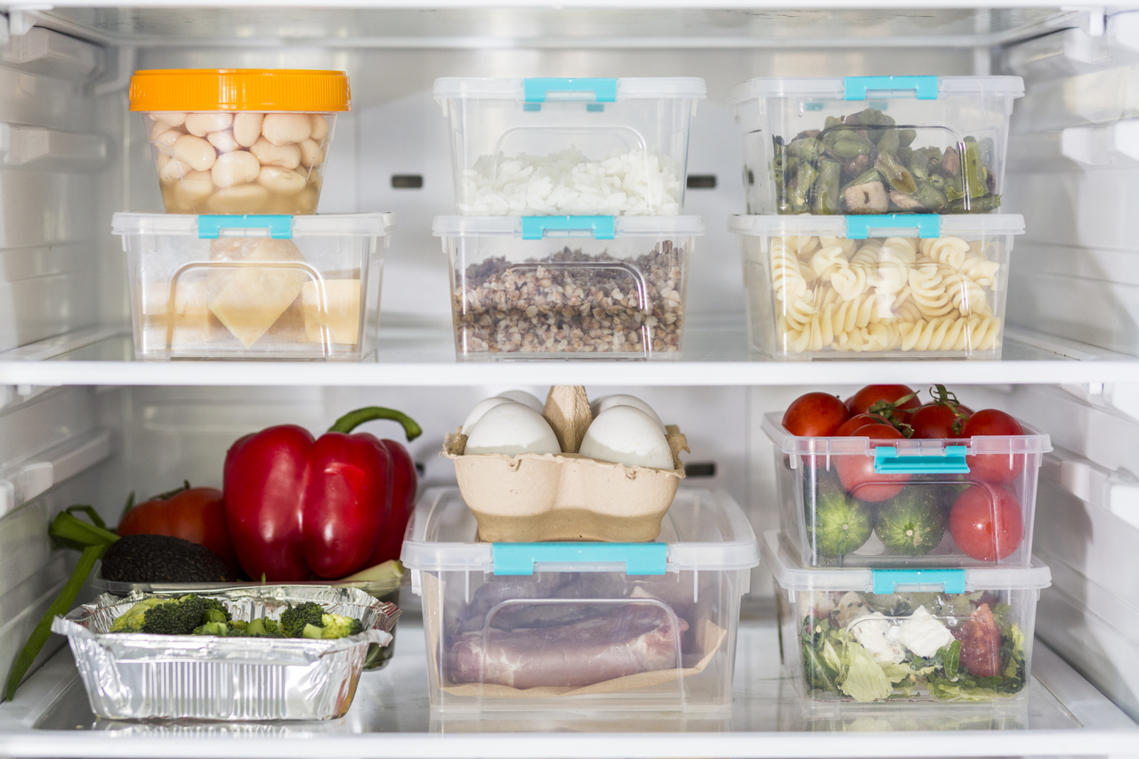 Plastic containers inside of a refrigerator
