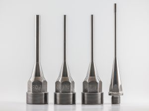 Nozzles for plastic injection molding