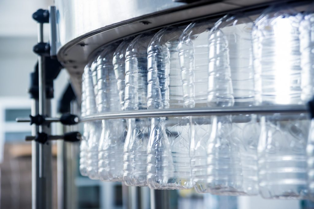 Plastic bottles on an automated manufacturing machine