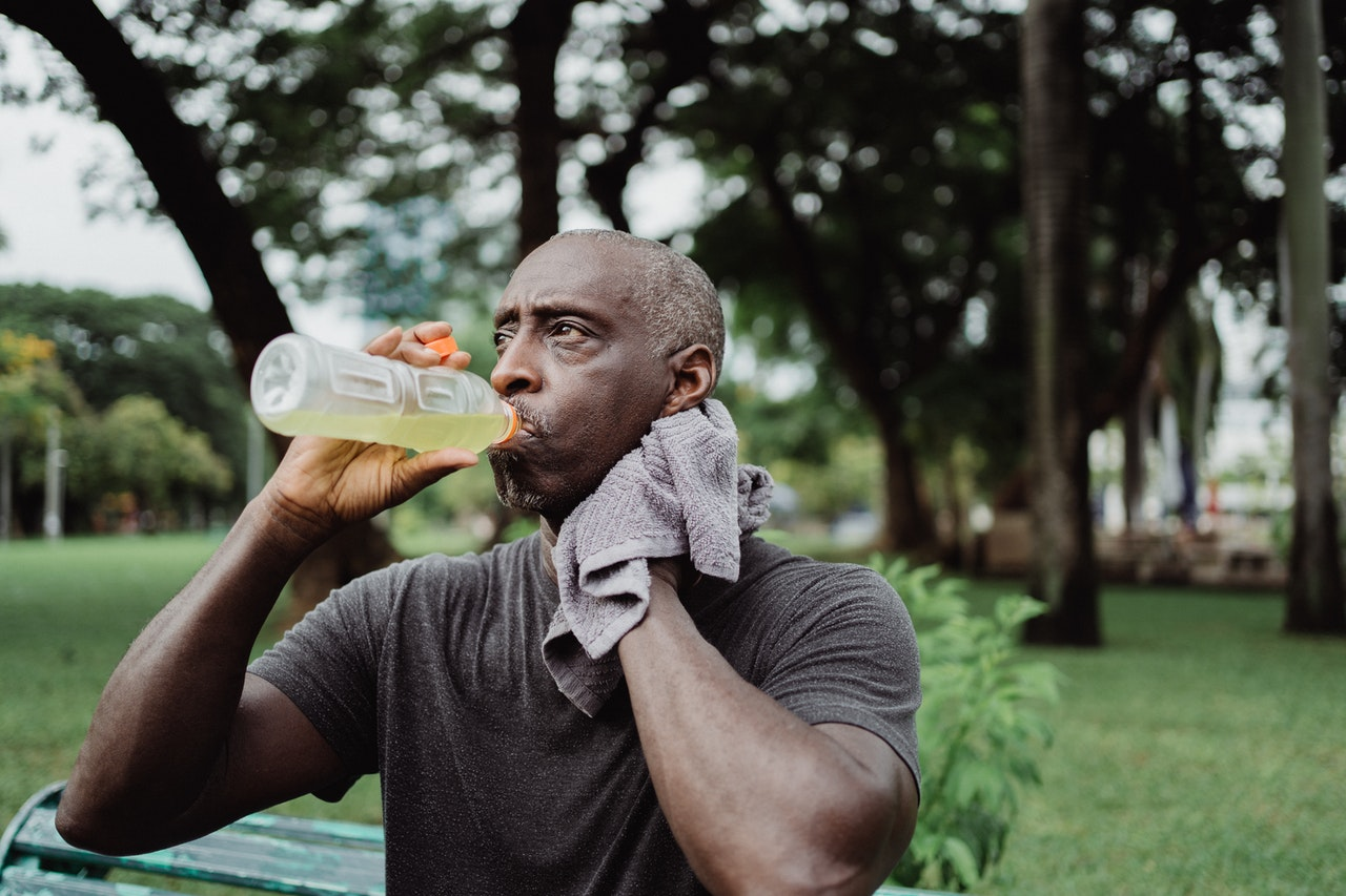 A man drinking from a plastic sports drink bottle