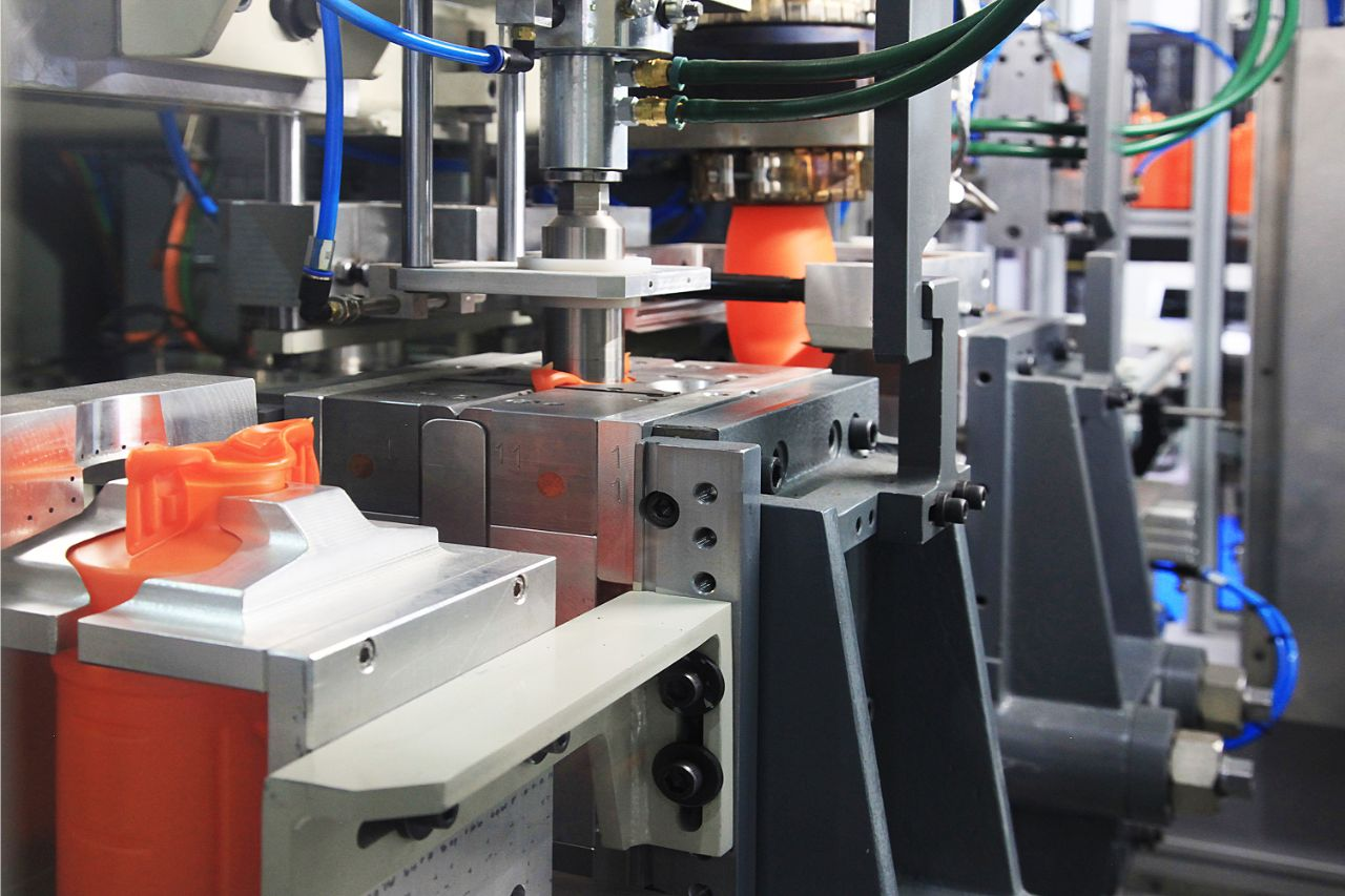 Close up of plastic injection molding machine