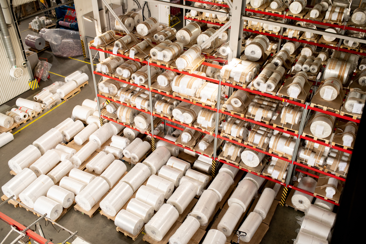 Rolled polyethylene film units on shelves and racks