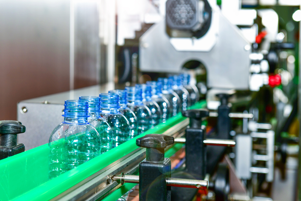 Plastic bottles lined in a machine