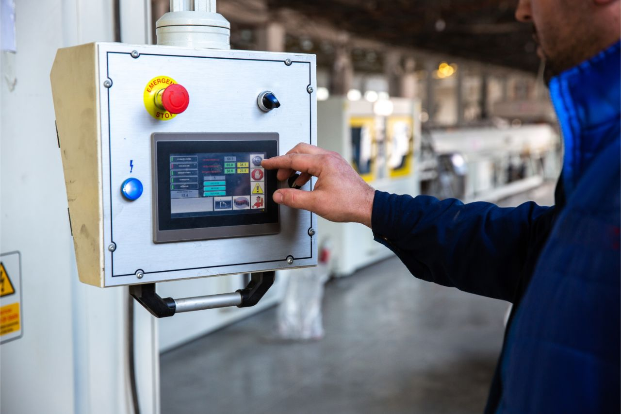 A worker working with a control panel